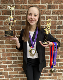 Lindsey Guilford (file photo with trophies and medals)
