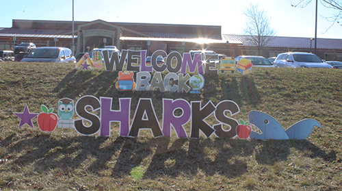 "The sign on the front lawn says ""Welcome back, Sharks"""